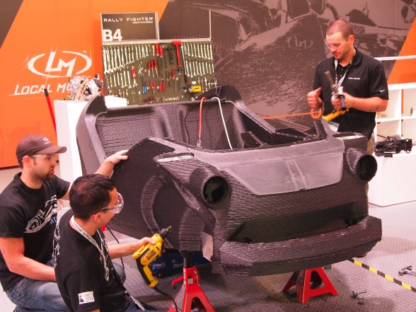 """The """"Strati,"""" a fully 3D printed car, was assembled on the IMTS floor.   -Photo by Bill O'Leary"""
