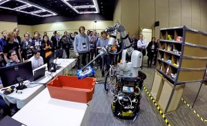 A robotic arm is shown picking and stowing a pack of Oreos at last year's competition in Seattle.