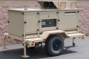 The east side of camp was powered by the Towable 100 kilowatt Generator Set, a generator that reduces fuel consumption by varying the engine speed to match the power load, resulting in a 20 percent reduction in fuel consumption.—U.S. Army photo
