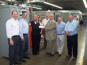 Pictured above: George Ardolino, AMETEK Division Vice President/Business Unit Manager, (center) presents $25,000 scholarship fund check to Vera Fosnot, Ohio State University Industry Liaison Director. Also pictured from left: Steve Wetta, Director of Engineering and Administration; Bogdan Proca, Director of R&D; Susan Midel, Director of HR; Nick Yarnell, Contracts Manager; Jim Lichtenberg, Business Manager of Prestolite Power; and Jason Cotton, Global Director of Sales and Service—AMETEK photo