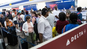 Delta passengers wait in line for flight changes on August 8th, 2016.