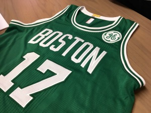 A rendering of a GE logo patch on a jersey of retired Celtic great John Havlicek.—Boston Magazine photo